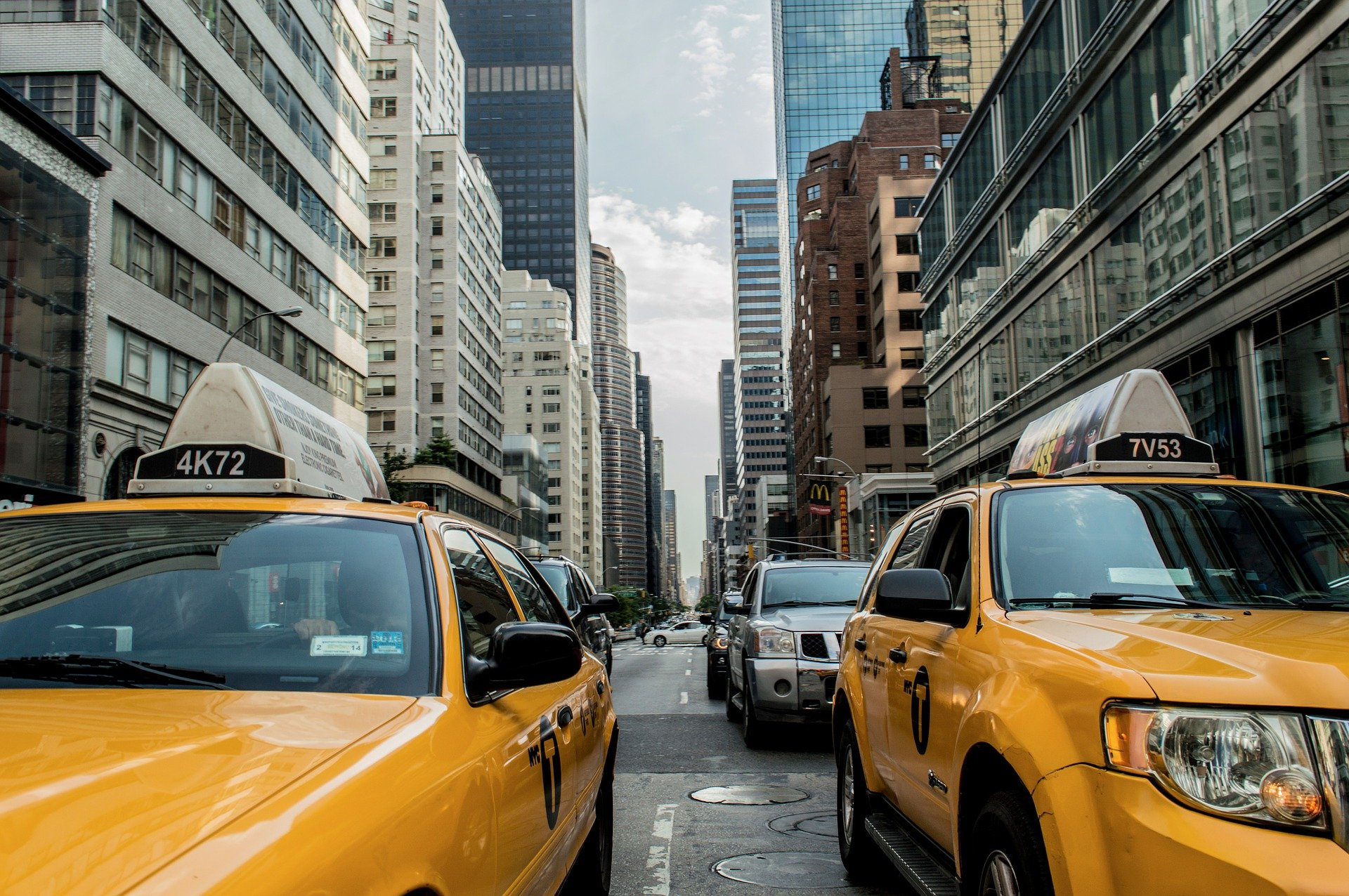 yellow taxis in traffic in a city